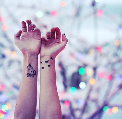 cage wrist tattoos